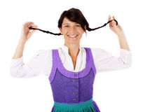 Woman in Dirndl with pigtails Stock Photography