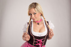 Woman with dirndl and plaits Stock Photography