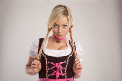 Woman with dirndl and plaits Royalty Free Stock Image