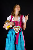 Woman in dirndl pointing at something Stock Photo