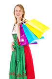Woman in dirndl on shopping tour Stock Photography