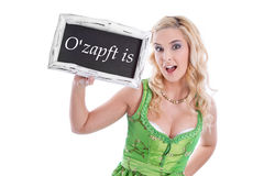 Woman in dirndl with signboard. O'zapft - Oktoberfest - isolated woman in dirndl with signboard stock photo