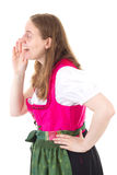 Woman in dirndl talking in vain Royalty Free Stock Photos