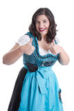 Woman in dirndl thumbs up. Woman in a blue dirndl thumbs up - isolated on white royalty free stock photos