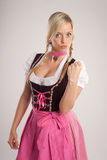 Woman with dirndl warns with fist Royalty Free Stock Image