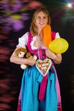 Woman in dirndl won some prizes at Oktoberfest Stock Image