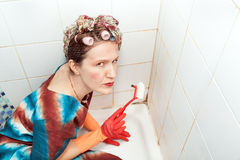 Woman and dirty bathroom Royalty Free Stock Photos