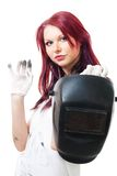 Woman in dirty gloves hold welder. Isolated on white Stock Images