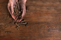 Dirty hands bolts washers repair service Stock Photography