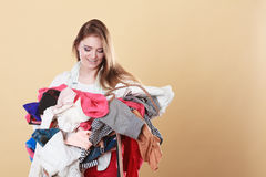 Woman with dirty laundry clothes. Royalty Free Stock Image