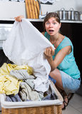 Woman with dirty linen near washing machine Royalty Free Stock Photography