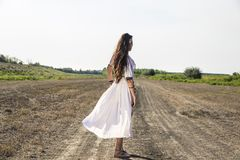 Pagan Woman on the dirty road turning stock images