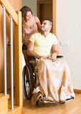 Woman with disabled husband at the door Royalty Free Stock Photos
