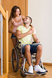 Woman with disabled husband at the door Stock Photos