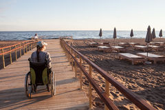 woman disabled on the terrace built specifically for disabled wheelchair stock image