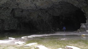 Woman disappearing in the cave stock video