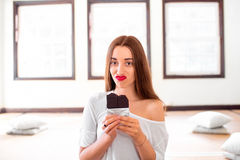 Woman with disappointed emotions holding chocolate Royalty Free Stock Photography
