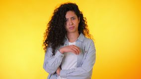 Woman disapproving with NO hand sign make negation finger gesture. Denying, rejecting, disagree, portrait of beautiful. Student girl or businesswoman on yellow stock footage