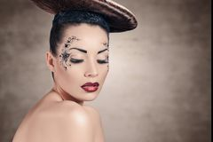 Woman with disc hairstyle. Beautiful stylish woman with disc hairstyle and fantasy make-up royalty free stock photography