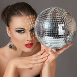 Woman with disco ball Royalty Free Stock Images