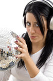 Woman with disco ball and headphone Royalty Free Stock Photo