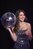 Woman with disco ball showing thumb up Royalty Free Stock Photo