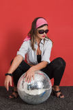 Woman with disco ball Stock Photography