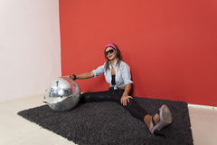 Woman with disco ball Stock Photos