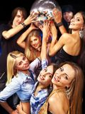 Woman on disco in night club. Group people on disco in night club. Lighting effects Royalty Free Stock Photography
