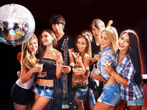 Woman on disco in night club. Group people on disco in night club. Lighting effects Stock Photos