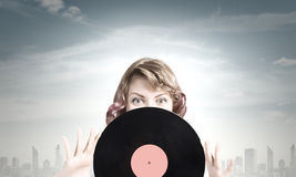 Woman with disco plate Royalty Free Stock Photo