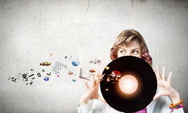 Woman with disco plate Stock Images