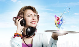 Woman with disco plate Royalty Free Stock Photography