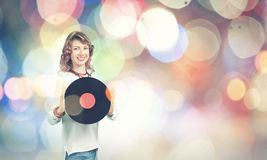 Woman with disco plate Royalty Free Stock Images