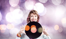 Woman with disco plate Royalty Free Stock Photos
