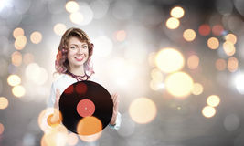Woman with disco plate Royalty Free Stock Image