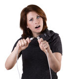 Woman disconnects cable. Pretty surprised woman disconnects cable, isolated on white Stock Images
