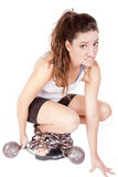 Woman discouraged chained to scales. A woman is on the scales and looks discouraged Royalty Free Stock Photo