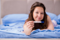 The woman discovering her positive pregnancy test royalty free stock image