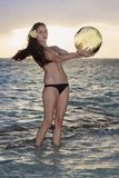 Woman discovers a glass float net ball Royalty Free Stock Images