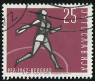 Woman discus thrower. RUSSIA KALININGRAD, 12 NOVEMBER 2016: stamp printed by Yugoslavia, shows woman discus thrower, circa 1962 Stock Photography