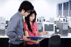 Woman discussing with her boss in office Stock Image