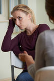 Woman Discussing Problems With Counselor. Young Woman Discussing Problems With Counselor Stock Photo