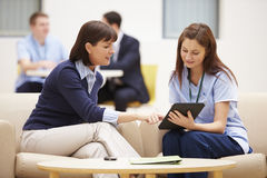 Woman Discussing Results With Nurse On Digital Tablet Stock Image