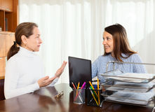 Woman discussing something with young girl Royalty Free Stock Images