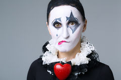 Woman in disguise harlequin Stock Photography