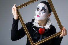 Woman in disguise harlequin. In the picture frame royalty free stock image