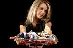 Woman with dish of candy Stock Photo