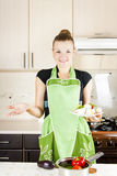Woman with a dish in the kitchen Stock Photo