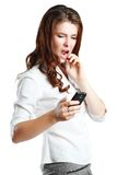 Woman dismayed she sees on phone Royalty Free Stock Images